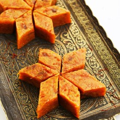 Homemade carrot halwa, traditional indian sweet, on brass tray